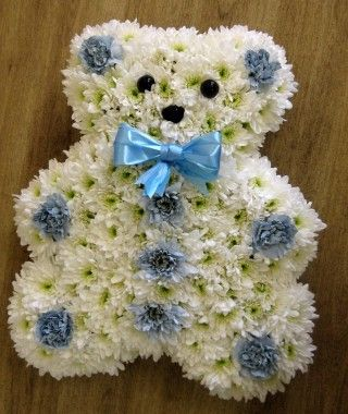 Blue teddy bear funeral tribute