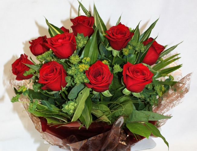 Dozen Red Rose Hand Tied in an aqua pack